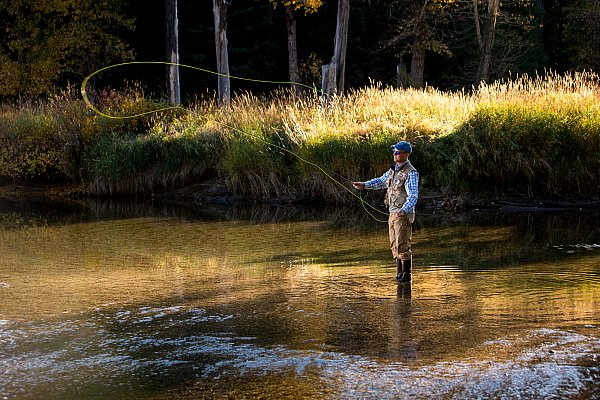 Fly-fishing-the-north-fork-of-the-payette-river-in-fall-just-outside-of-mccall-idaho